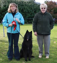 Bev Hall with Ailort Inspyre and obedience judge Mrs L Whales